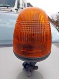 Yellow flashing light 2. Removable yellow flashing light for traffic warning Royalty Free Stock Photography