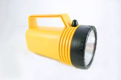 Yellow Flashlight. Yellow and black flashlight for protection in case of hurricane in Florida stock photography