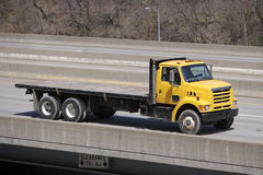Yellow Flat Bed Truck. On the Road Stock Images
