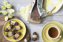 Typical cookies from The Netherlands, with chocolate and almonds, called Bokkepootje and cup of tea royalty free stock image