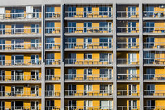 Yellow flats of block. With balconies Stock Photos