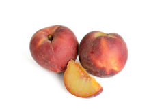 Yellow flesh American peaches slice and whole. Yellow-fleshed fresh American peaches slice and whole  on white Royalty Free Stock Images