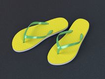 Flip flops on the street. Yellow flip flops on the asphalt stock photos
