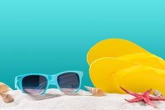 Yellow flip flops on beach against blue background. Yellow flip flops on beach against blue background Stock Photos