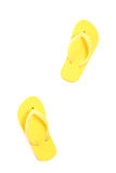 Yellow flip flops isolated on white royalty free stock image