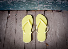 Yellow Flip-Flops On The Porch Stock Photo