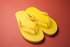 Yellow flip-flops Stock Image