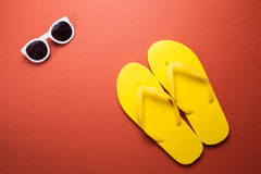 Yellow flip flops and sunglasses Royalty Free Stock Photo