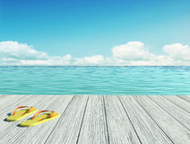 Yellow flip flops on a wooden floor by the seashore Royalty Free Stock Photos