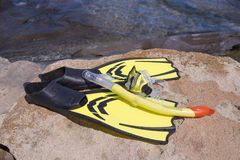 Yellow flippers and diving mask on the beach Royalty Free Stock Photo