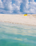 Yellow flippers for swimming on the beach. Maldivian island Stock Photo