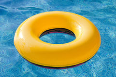 Yellow float floating in the pool Royalty Free Stock Images