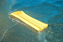 Yellow Floating air mattress Stock Photos