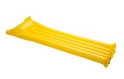 Yellow floating pool raft Royalty Free Stock Image