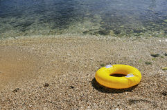 Yellow floating toy Stock Photo