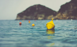 Yellow Floating Water Craft on Body of Water Stock Photography