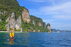 Yellow floats near Khao Phing Kanu islands in Thailand Royalty Free Stock Image