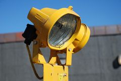 Yellow floodlight. A yellow industrial floodlight used by the construction industry Stock Photo