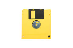 Yellow floppy disk. Isolated on white stock photos
