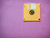 Yellow floppy disk. Vintage yellow floppy disk on Magenta background Stock Images