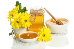 Yellow flower and bee products honey, pollen. On white background royalty free stock image