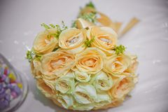 Yellow flower bouquet and rings for wedding. Yellow roses Royalty Free Stock Image