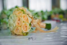 Yellow flower bouquet and rings for wedding. Yellow roses Stock Photos
