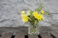Yellow Flower on Cafe Table Stock Images
