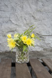 Yellow Flower on Cafe Table Royalty Free Stock Image