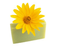 Yellow flower and green soap on white Royalty Free Stock Images