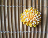 Yellow flower-shaped hand made soap. On beige background Stock Images