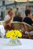 Yellow flower on a table Stock Photo