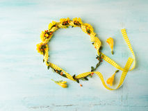 Yellow flower wreath girl head band on pastel background Stock Image