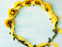 Yellow flower wreath girl head band on pastel background Stock Photography