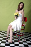 Yellow flowers. Young woman modeling with whie dress and yellow flowers Royalty Free Stock Images