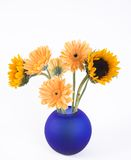 Yellow flowers. Spring flowers in blue vase royalty free stock image