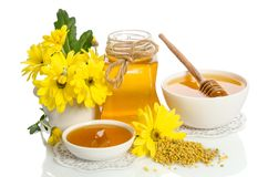 Yellow flowers and bee products honey, pollen. On white background stock photography