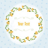 Yellow flowers border and green vignette on the light blue leaf background royalty free stock photos