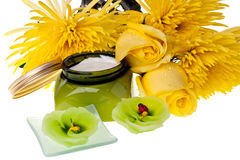 Yellow flowers ,candle and body lotion Stock Photo