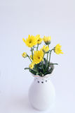 Yellow flowers chrysanthemums in a vase on a white background Stock Photos