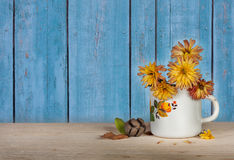 Yellow flowers in cup Royalty Free Stock Images