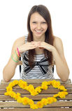 Yellow flowers dandelions in form of Heart. One teenage girl 16 Stock Photo