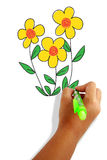 Yellow flowers doodle. Girls hand holding a pen drawing yellow  flowers Royalty Free Stock Photos