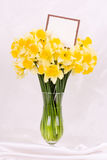 Yellow flowers in a glass vase Royalty Free Stock Photos