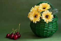 Yellow flowers in green basket Royalty Free Stock Photo