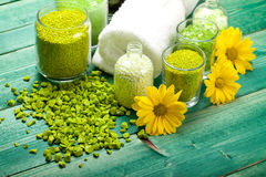 Yellow flowers and green bath salt Stock Photo