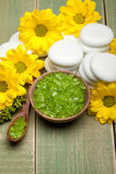 Yellow flowers and green spa minerals royalty free stock images