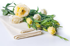 Yellow flowers and linen napkins Royalty Free Stock Photos