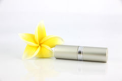 The Yellow flowers and Lipstick casing Silver. Stock Photography