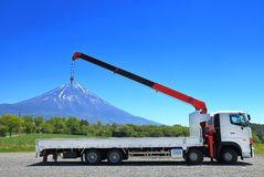 Truck Crane & Mount Fuji. A view of Mount Fuji from the Asagiri Highlands with a truck in the foreground appearing to be lifting Mount Fuji stock images
